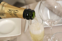 Serving a glass of Champagne Royalty Free Stock Photography