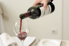 Serving a glass of red wine Royalty Free Stock Photography