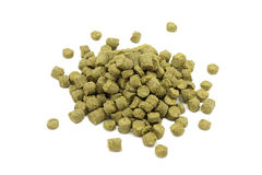A serving of granulated green hops. On a white background Stock Image