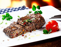 Serving of grilled beef steak Royalty Free Stock Photo
