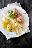 Serving of ham, asparagus and potatoes Stock Photos