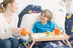 Serving healthy breakfast to her little patient Royalty Free Stock Photography