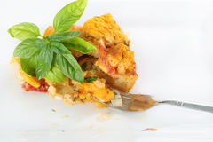 Serving of heirloom tomato bread pudding with fork Royalty Free Stock Images