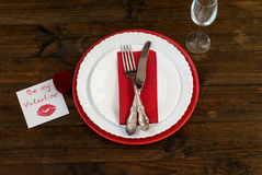 Serving holiday table, spoon, fork, knife, white plates Royalty Free Stock Photos