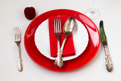 Serving holiday table, spoon, fork, knife, white plates Stock Image
