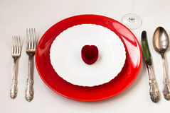 Serving holiday table, spoon, fork, knife, white plates Royalty Free Stock Photography