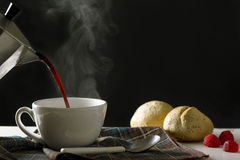 Serving hot coffee in the living room of his home Royalty Free Stock Images