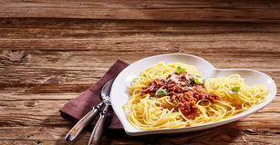 Serving of Italian spaghetti on a rustic table royalty free stock photography