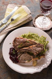Serving of lamb ribs grilled, mashed potatoes, beetroot sauce, lemon, wine, napkin on the table Royalty Free Stock Images