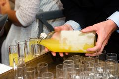 Serving limoncello in glasses Royalty Free Stock Photo