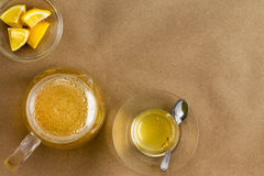 Serving of linden tea and lemon with copy space Stock Photos