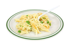 Serving of linguine with peas on plate with fork Stock Photos