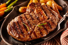 Serving of marinated rib eye steak with potatoes Stock Images