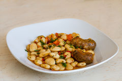 Sausages with beans. A serving of meat with beans royalty free stock images