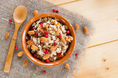 Serving muesli scattering of nuts on wooden table Stock Images