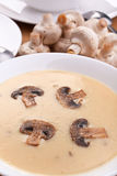 Serving of mushroom cream soup stock photography