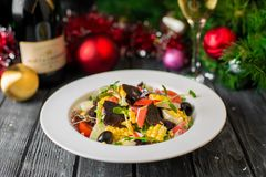 Serving the New Year`s table for several people with a Christmas tree. Photos in the interior Royalty Free Stock Photography