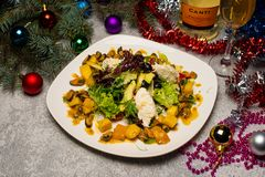 Serving the New Year`s table for several people with a Christmas tree. Photos in the interior.  stock photography