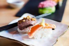 Serving sushi stock photos