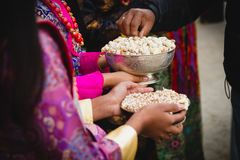 Serving Nuts at the Party. Unknown girls serving Assorted Nuts at the party royalty free stock photo