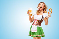 Serving at Oktoberfest. Stock Photos