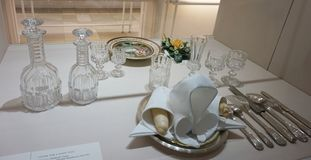 Serving for one person. Cutlery set of the Habsburg family at the Imperial Silver Collection at the Hofburg. Shelving with goldware, which was used by the stock image