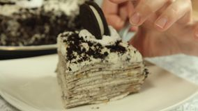 Serving oreo crape cake slice. With exotic fruits in the home kitchen closeup stock footage