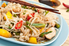 Serving of oriental warm noodle chicken salad. With chopsticks and soy sauce Stock Image