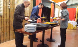 Serving Paella in Spain Stock Images