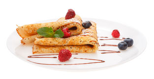 Serving pancakes with fresh berries on the plate. Royalty Free Stock Photography