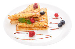 Serving pancakes with fresh berries on the plate. Royalty Free Stock Photos