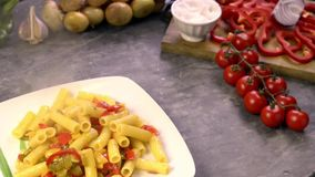 serving pasta with peppers on the plate stock footage