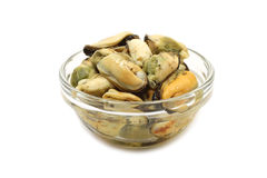 A serving of pickled sea mussels in a glass bowl. On a white background Royalty Free Stock Photography
