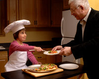 Serving Pizza to Grandpa Stock Photos