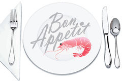 Serving plates and cutlery. Decorated with shrimp and inscription bon appetit Stock Photo