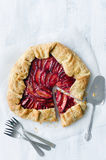 Serving plum galette, shot from overhead Royalty Free Stock Image