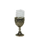 Serving power alternatives. Spiral light bulb that uses less resources, silver antique chalice with grapes and leaves embossed on the sides Royalty Free Stock Photos