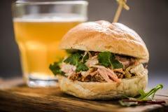 Serving pub food, pork bap with cider. Serving pub food, pork bap with coleslaw, on wooden board with cider Stock Images
