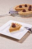 Serving of pumpkin pie. Royalty Free Stock Image