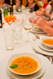 Serving pumpkin soup Royalty Free Stock Images