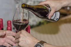 Serving red wine on a wineglass Royalty Free Stock Photo
