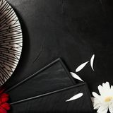 Serving restaurant setting sophisticated style. Stylish table setting at restaurant. Fancy plates and tender flowers on black background concept Stock Photos