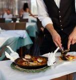 Serving seafood paella Stock Photo
