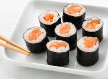 Serving of seven hosomaki salmon sushi Royalty Free Stock Photo