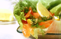 Serving smoked salmon salad Stock Photography