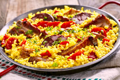 Serving of speciality Spanish Al Homo paella Stock Images