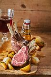 Serving of barbecued lamb chops in a rustic tavern royalty free stock images