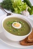 Serving of spinach cream soup Stock Photos