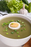Serving of spinach cream soup with vegetables Stock Photo