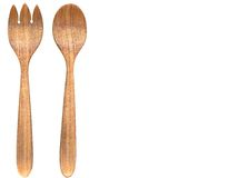 Serving spoons. Wooden serving spoons on a white background Royalty Free Stock Photography